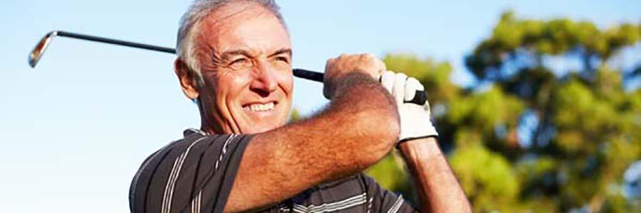 fort collins bridges - older man playing golf