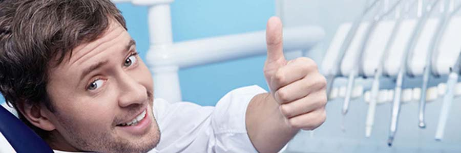 dentist in fort collins - young man with thumbs up